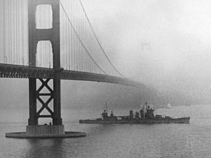 USS San Francisco (CA-38) steams under the Golden Gate Bridge on 11 December 1942 (80-G-40093).jpg