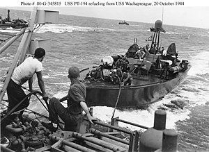 USS Wachapreague (AGP-8) - USS Wachapreague (AGP-8) refuels a PT boat on 20 October 1944 during the voyage from Palau to Leyte.