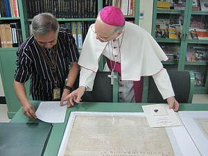Archives of the University of Santo Tomas - Archbishop Angelo Vincenzo Zani, Secretary of the Congregation for Catholic Education of the Holy See (Vatican), examining historic documents related to the university's establishment during his visit to the Archives, on 21 January 2015.