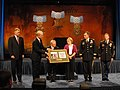 US Army 51326 Outgoing Army Secretary Pete Geren presents Paul and Janet Monti with a plaque honoring their son Sgt. 1st Class Jared Monti, during Monti's induction into the Pentagon's Hall of Heroes.jpg