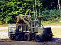 US Navy 020911-N-2834H-002 An equipment perator assigned to Naval Mobile Construction Battalion 23 operates a front-loader.jpg