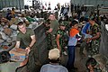 US Navy 050104-M-9792P-015 Marines assigned to 3rd Transportation Support Battalion, 3rd Force Service Support Group, help distribute humanitarian relief supplies at Palonia Air Field in Medan, Indonesia.jpg