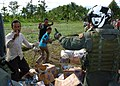 US Navy 050113-N-8629M-100 Aviation Machinist's Mate 2nd Class Derek Barnum returns a thumbs up to appreciative Indonesian men after dropping a load of humanitarian relief supplies for Tsunami victims near the coastal regions o.jpg