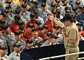 US Navy 050804-N-0962S-140 Master Chief Petty Officer of the Navy (MCPON) Terry Scott speaks to Sailors about the importance of personal readiness at an all hands call in the well deck aboard the amphibious assault ship USS Bat.jpg