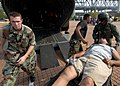 US Navy 050903-N-5526M-009 Army National Guard air crewmen and Air Force National Guard personnel load a Hurricane Katrina victim onto an Army CH-47 Chinook helicopter during relief efforts in New Orleans.jpg