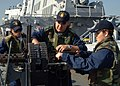 US Navy 051021-N-4374S-001 Sailors aboard the guided missile destroyer USS Ross (DDG 71) man a twin .50 caliber machine gun mount.jpg