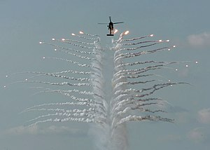Active protection system - An HH-60H Seahawk helicopter discharges countermeasure flares