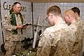 US Navy 051225-M-7173M-008 U.S. Navy Chaplain, Lt. Tim Hall, leads U.S. Marines with Gulf Company, 2nd Battalion, 6th Marine Regiment, in prayer during a special Christmas service in Iraq.jpg