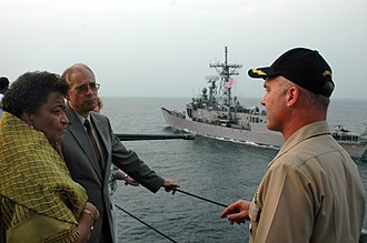 United States Sixth Fleet - The newly elected president of Liberia, Ellen Johnson-Sirleaf, tours the U.S. Navy's Sixth Fleet command and control ship USS Mount Whitney (LCC 20) escorted by Commander, Task Force 65, Captain Tom Rowden, right, while the frigate USS Carr (FFG 52) moves alongside the ship. Making her first ever visit aboard a navy vessel, President Johnson-Sirleaf visited Mount Whitney the day after her inauguration to thank the crew for making the journey in support of her countries inaugural ceremonies.