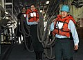 US Navy 060215-N-4954I-067 Deck Department Sailors move one of the mooring lines to the well deck aboard the amphibious assault ship USS Peleliu (LHA 5).jpg