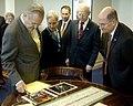 US Navy 060221-N-0696M-016 Secretary of Defense (SECDEF), the Honorable Donald H. Rumsfeld, left, and Secretary of the Navy (SECNAV), the Honorable Dr. Donald C. Winter, right, look at several artifacts in Rumsfeld's offi.jpg