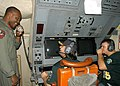 US Navy 061113-N-0068G-085 Aviation Warfare Systems Operator 2nd Class Trevor Godwin, of Tampa, Fla., demonstrates the crew coordination system on a P3-C Orion to professional baseball players Nick Swisher and Joe Blanton.jpg