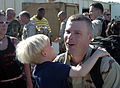 US Navy 070301-N-7365L-003 Chief Steelworker Allen Egelston gets a big hug from his son during a homecoming ceremony for Naval Mobile Construction Battalion (NMCB) 5, following their deployment to the Middle East.jpg