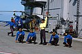 US Navy 070904-N-5242D-005 Sailors aboard Indian Navy aircraft carrier INS Viraat (R 22) give the all-clear signal to visiting Sailors aboard an SH-60 Seahawk assigned to Helicopter Anti-submarine Squadron (HS) 6.jpg