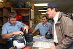 US Navy 071130-N-0486G-006 During a tour of Naval Station Mayport's Helicopter Anti-Submarine Squadron (HSL) 40, Ed Begley Jr. watches as Air Warfare Systems Operator 1st class Glen Premo attaches a pair of night vision goggles.jpg