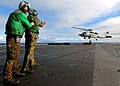 US Navy 071208-N-8132M-127 Sailors aboard the nuclear-powered aircraft carrier USS Enterprise (CVN 65), direct an HH-60H Seahawk helicopter.jpg