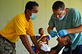 US Navy 080824-N-9689V-001 Lt. Cmdr. Rich Kolanda, a dentist from the U.S. Public Health Service, performs a tooth extraction during a Medical and Dental Civic Action Program (MEDCAP) held on Uman, an island in Chuuk State, Fed.jpg
