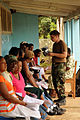 US Navy 081117-N-8907D-170 Hospital Corpsman Michael Hagglung talk with patients awaiting eye examinations during medical operations at the Port Kaituma Skills Training Centre.jpg