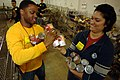 US Navy 090219-N-7544A-109 Air Traffic Controller 2nd Class Lamar Jones and Air Traffic Controller 3rd Class Allison Hamm sort through canned goods at The Food Bank of Southeastern Virginia.jpg