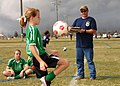 US Navy 090228-N-8816D-178 Chief Builder Robert Tyree, right, assigned to Naval Mobile Construction Battalion (NMCB) 133, counts the number of times each participant can juggle a soccer ball without dropping it during a 2009 Gr.jpg