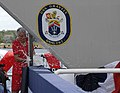 US Navy 090516-N-0860R-135 Alma Bernice Clark Gravely, ship's sponsor for pre-commissioning unit (PCU) Gravely (DDG 107) breaks the traditional bottle of Champaign over the ship's bow.jpg
