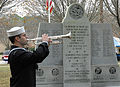 US Navy 091207-N-0000X-002 A bugler plays taps during a Pearl Harbor Remembrance Ceremony at Joint Expeditionary Base Little Creek-Fort Story.jpg