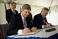 US Navy 100121-N-5549O-068 ecretary of Agriculture Thomas Vilsack and Secretary of the Navy (SECNAV) the Honorable Ray Mabus sign a memorandum of understanding at the Pentagon.jpg