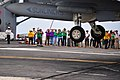US Navy 100303-N-2953W-873 Brazilian visitors photograph an F-A-18 Super Hornet landing on the flight deck of the nuclear-powered aircraft carrier USS Carl Vinson (CVN 70). Carl Vinson is underway supporting Southern Seas 2010.jpg
