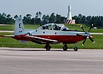 US Navy 100518-N-0321D-002 Ensign Christopher Farkas taxis a new T6-B Texan II. Farkas is the first student to train in the T6-B Texan II.jpg