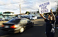 US Navy 100824-N-7498L-075 Ship's Serviceman 1st Class Telehia Sutherland holds a watch for keiki sign along Lehua Avenue in Pearl Harbor, Hawaii, to raise awareness about driving safely and reducing speed in a school zone.jpg