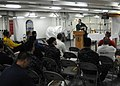 US Navy 101017-N-6092D-018 Lt. Ben Garrett, a Navy chaplain, delivers his sermon during Roman Catholic mass for Sailors aboard the aircraft carrier.jpg