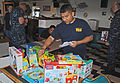 US Navy 101221-N-8374E-851 Chief Aviation Electronics Technician Enrique Fraga selects toys for Christmas baskets.jpg
