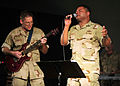 US Navy 110408-N-1755G-068 Musicians 2nd Class Chris Morrison, left, and Kori Gillis, both assigned to the U.S. Naval Forces Band Europe and Africa.jpg