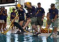 US Navy 110517-N-VA590-098 Navy Diver 1st Class Dale Park, center, assigned to Southwest Regional Maintenance Center, jumps into a dive training po.jpg