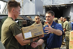 US Navy 111210-N-KS651-629 Sailors and Marines move supplies during a replenishment at sea.jpg