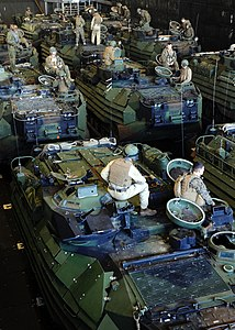 US Navy 111215-N-QM601-265 Amphibious assault vehicles assigned to Battalion Landing Team (BLT) 1-2 prepare for a beach raid exercise aboard the am.jpg