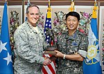 United States Air Force Chief of Staff Gen. Mark A. Welsh III and Republic of Korea Air Force Chief of Staff Gen. Sung Il-Hwan exchange gifts following a meeting in Seoul.JPG