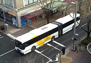 English: A Volvo articulated bus in contract s...