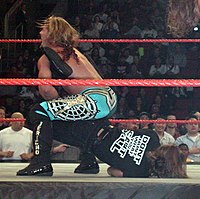 Chris Jericho portant à Shawn Michaels le Walls of Jericho (Elevated Boston Crab)