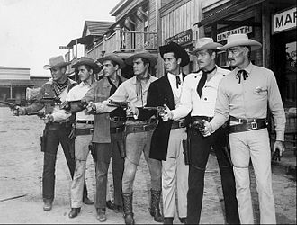 Warner Bros. Television - Publicity still with 1959 Warner Bros. series leads Will Hutchins (Sugarfoot), Peter Brown (Lawman), Jack Kelly (Maverick), Ty Hardin (Bronco), James Garner (Maverick), Wayde Preston (Colt .45), and John Russell (Lawman)