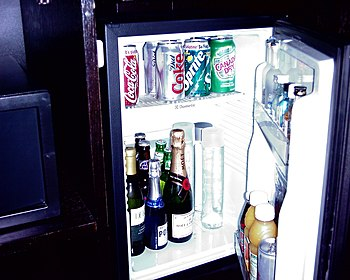 A refrigerated mini-bar in a hotel