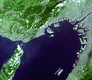 Kansai International Airport - Satellite photo of Kansai Airport (lower-right island) in Osaka Bay. Kobe Airport is being built on the unfinished island near the middle of the photo. Central Osaka is in the upper-right corner, along with Osaka International.