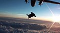 Wingsuit Catching Flight at Sunset (6367632545).jpg