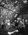 With nearly 3,000 pin-ups (including over 200 shots of Marilyn Monroe) serving as wallpaper for their quonset hut... - NARA - 532470.tif