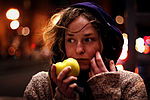 Woman eating an apple.jpg