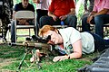 Woman watching throug a scope of an M110 at Fuerzas Comando 2011.jpg