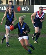A Melbourne University player takes possession of the ball in the 2007 VWFL Grand Final won by the Darebin Falcons.