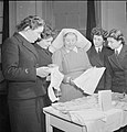 Wrens Learn Mothercraft- Members of the Women's Royal Naval Service Receive Training From the Mothercraft Training Society, London, England, UK, 1945 D23647.jpg
