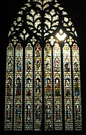 A very large window of eight lights rising to elaborate tracery in the form of a sacred heart