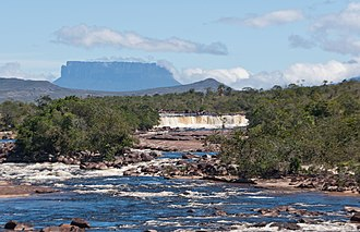 Gran Sabana - Yuruaní River, with the tepui of same name in the background